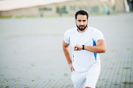 Fitness. Young man running in urban environment