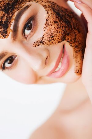 Face Skincare. Young Charming Girl Makes a Black Charcoal Mask on Her Face Stock Photo