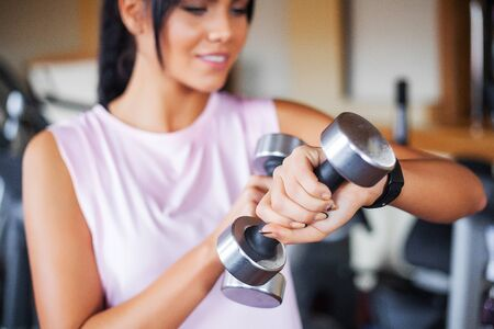 Fitness woman. Young attractive woman doing exercises in fitness gym. Stock Photo