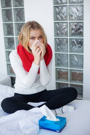 Sick woman suffers from a cold at home Stock fotó