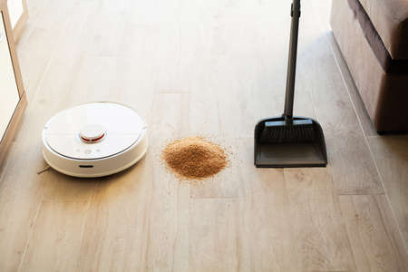 Comparison of Robot Cleaner and Broom in Bright Room 写真素材