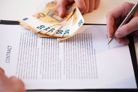 Employee is given a bribe for a favorable signing of the contract