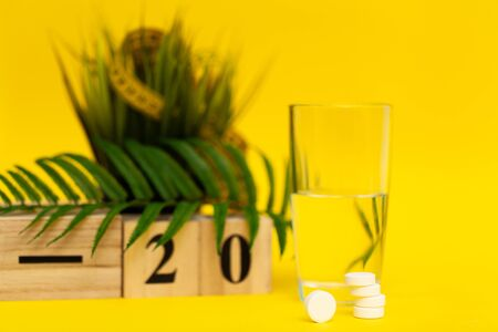 Glass of water and pill for weight loss Stock Photo