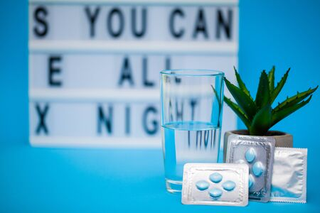 Pills that promote sexual health for men for a long time on blue background