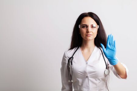 Doctor showing hand stop gesture, health safety concept