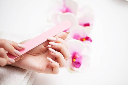 Woman in a beauty studio doing a new manicure.