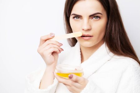 Care concept, woman holding bowl with wax for hair removal Archivio Fotografico - 147917040