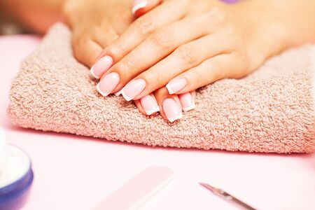 Beautiful woman hands with fresh french manicure.