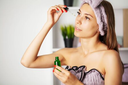 Women skin care, cosmetic oil vitamins to restore facial skin Standard-Bild