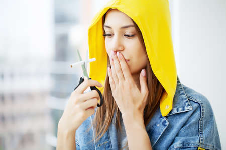 Stop smoking, young woman breaks a cigarette urging to quit smoking