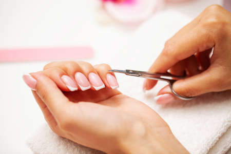 Woman close up of doing manicure on hands 写真素材