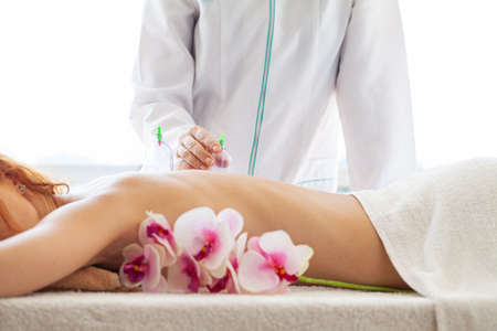 Beautiful woman relaxing in spa salon with vacuum body massage
