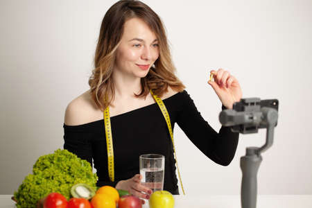 Nutritionist records a video blog about healthy eating on a mobile phone