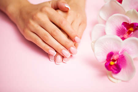 Young woman after getting professional manicure in beauty salon Archivio Fotografico