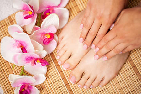 The picture of female legs and hands after pedicure and manicure