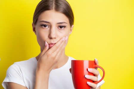 Woman experiencing severe toothache holding her hand over her cheek