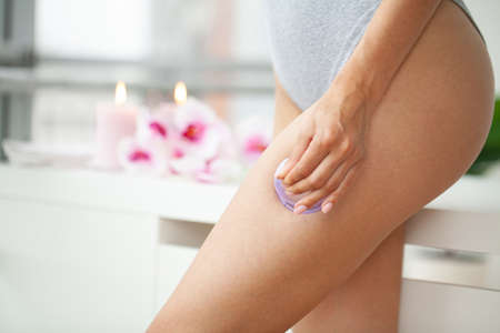 Woman getting anti-cellulite massage of hips with use of vacuum cans in beauty studio Zdjęcie Seryjne