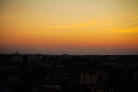Airplane take off over the panorama city at twilight scene
