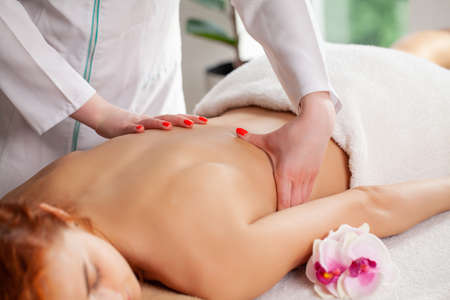 Spa, relaxed woman receiving a back massage