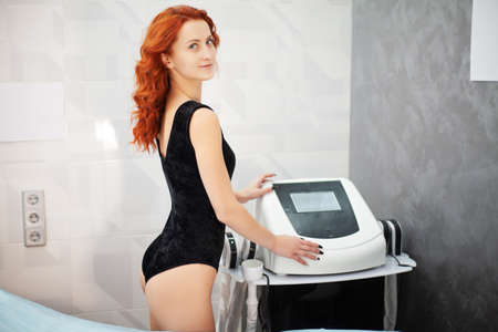 A woman in a private clinic is waiting for electrical stimulation procedure