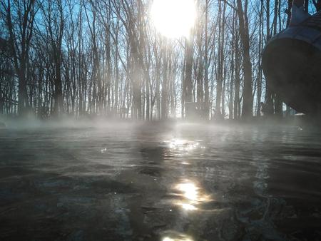 Geothermal pool, steam on water