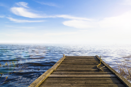 Fantastic view of the wooden pier in the lake. Scenery background Stock Photo