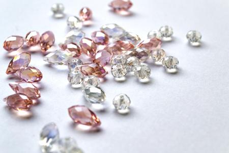 Crystal beads on white background. Closeup shot Stock Photo