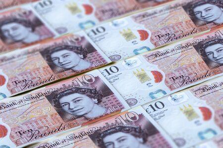 Sfondo di banconote in sterline britanniche. Soldi del Regno Unito. 10 sterline Archivio Fotografico