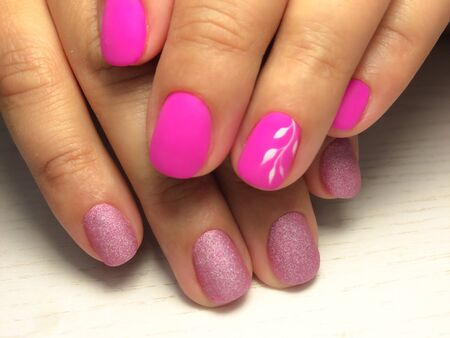 Nails care. Woman hands with pink manicure. Closeup photo. Beauty, healthcare
