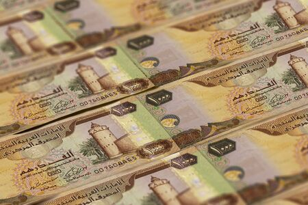 United Arab Emirates Dirham banknotes background. UAE Dirhams pattern. 1000 dirhams Stock Photo