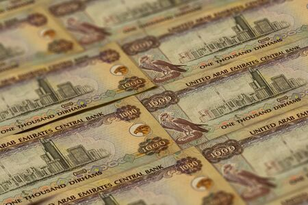 United Arab Emirates Dirham banknotes background. UAE Dirhams pattern. 1000 dirhams Banco de Imagens