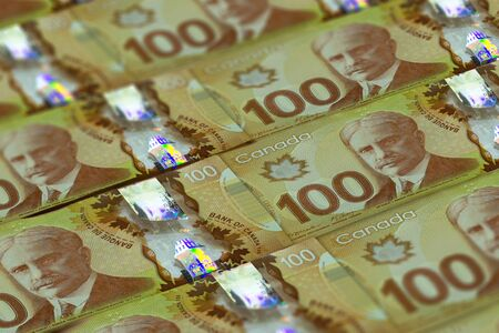 CAD. Canadian currency background. Closeup photo. Dollars of Canada
