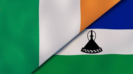 Two states flags of Ireland and Lesotho. High quality business background. 3d illustration Stock fotó