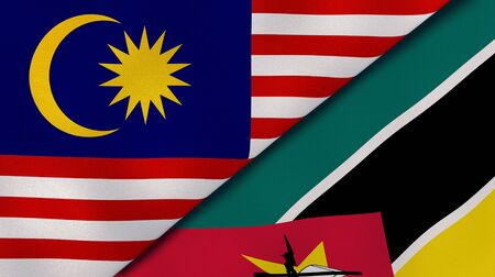Two states flags of Malaysia and Mozambique. High quality business background. 3d illustration Stock fotó