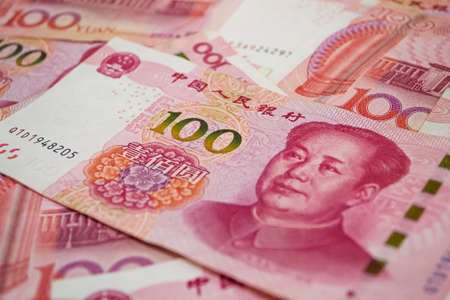 100 Chinese Renminbi banknotes background. China, Beijing.
