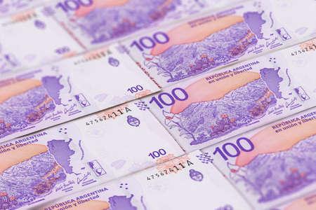 Closeup Argentine pesos banknotes background. ARS pattern. 100 pesos