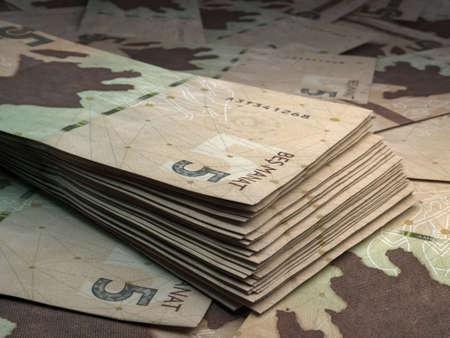 Money of Azerbaijan. Azerbaijani manat bills. AZN banknotes. 5 coins. Business, finance, news background.