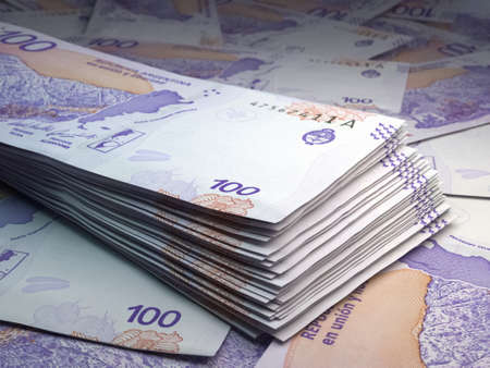 Money of Argentina. Argentine peso bills. ARS banknotes. 100 pesos. Business, finance, news background.