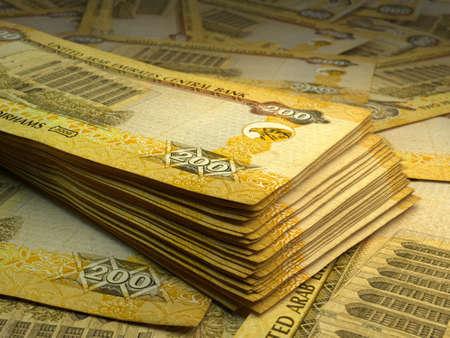 Money of United Arab Emirates. United Arab Emirates dirham bills. AED banknotes. 200 dirhams. Business, finance, news background.