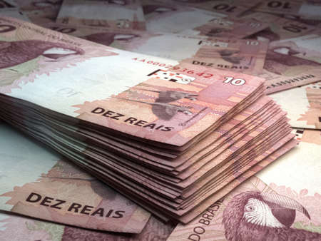 Money of Brazil. Brazilian real bills. BRL banknotes. 10 reals. Business, finance, news background.