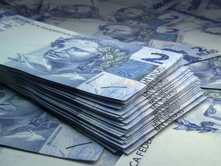 Money of Brazil. Brazilian real bills. BRL banknotes. 2 reals. Business, finance, news background.
