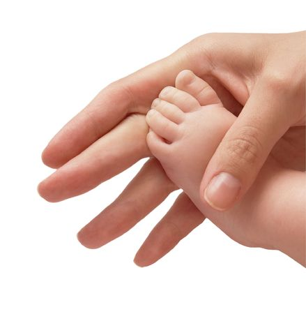 Leg of the child in a hand of mum Stock Photo