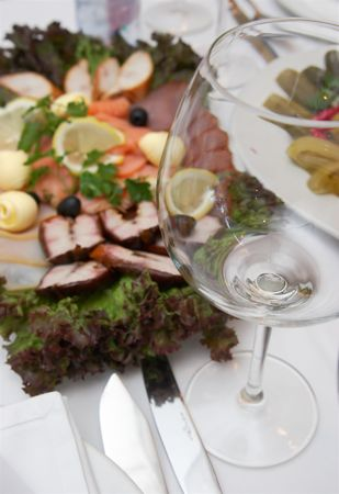 viands: Empty glass and plate with fish viands Stock Photo