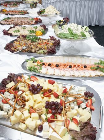 cater: Buffet table. Fast meal. Cheese a fish