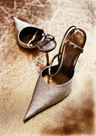 Ladies shoes on heels on a gold background Stock Photo