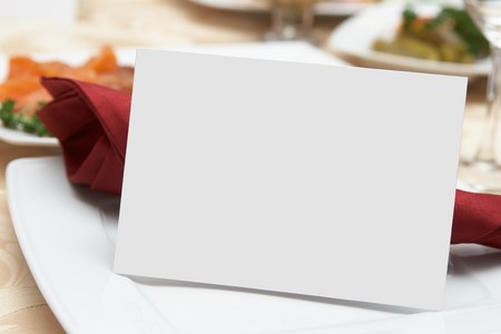 Place setting and card on a table at a reception. Stock Photo