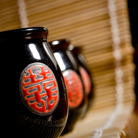 The Japanese cups for tea of black colour with red drawing