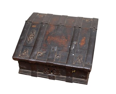 old, history grungy wooden treasure chest with rusty metal decoration. Isolated on white. photo