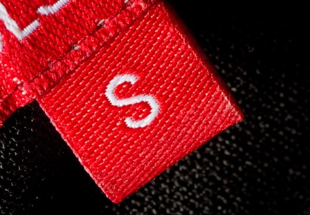 checked shirt: real macro of s size clothing label Stock Photo