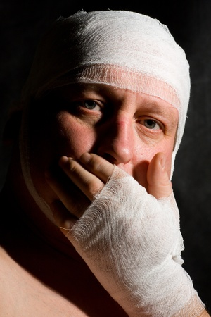 a man bandaged up with a head injury photo